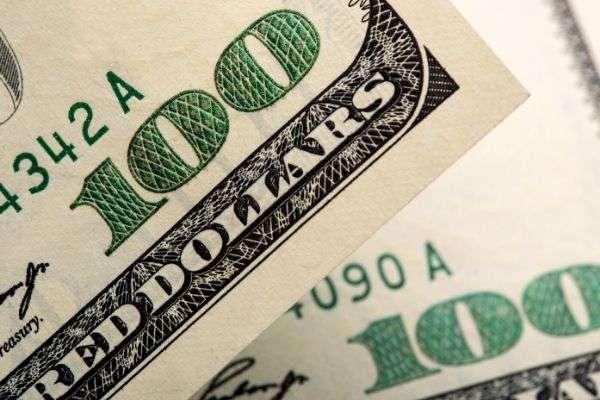 Two $100 bills